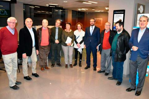 Miembros del Rotary y de La Caixa durante la presentación de las ayudas