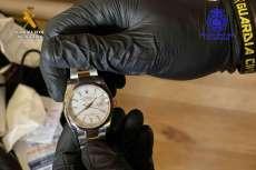 Reloj en manos de una persona
